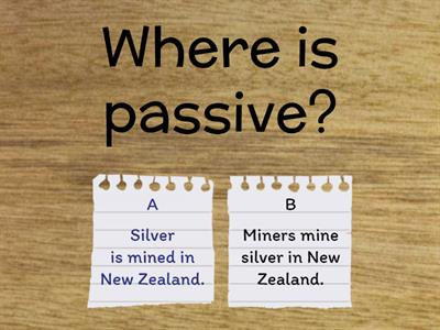 Choose the passive sentence in each pair